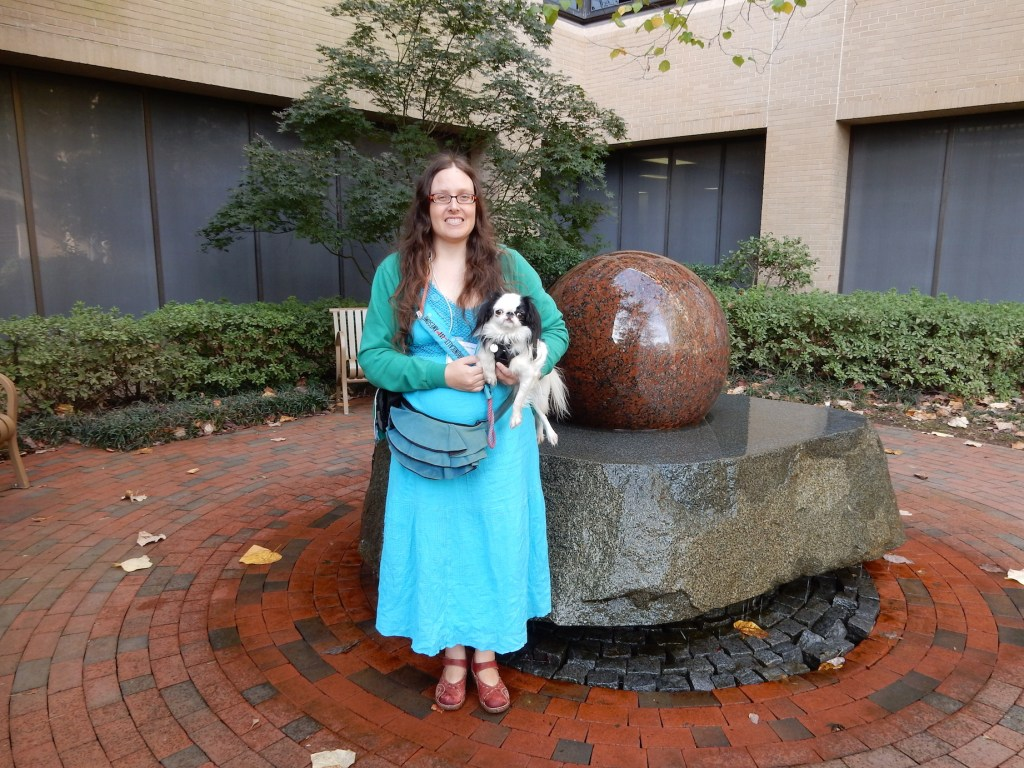 Veronica and Hestia, both decked out in turquoise, in front of the granite ball fountain