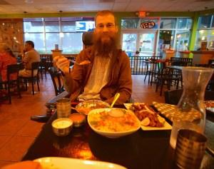 Brad eating yummy Indian food