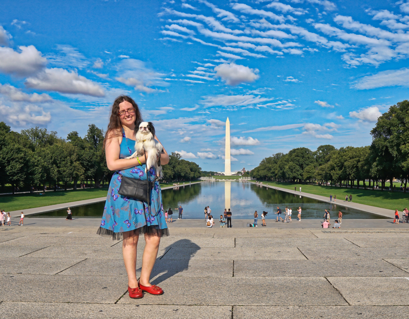 Veronica and Hestia in front of the reflecting pool. The sky is an awesome Carolina blue