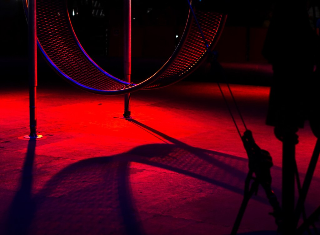 A dramatic shot of the wheel of death in red lighting.