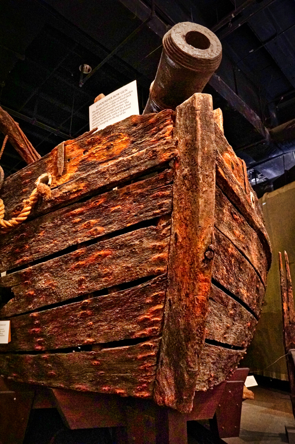 A very old wooden gunboat hull with a cannon on top. We wanted to see more, but didn't want to deal with getting an employee for the wheelchair lift this display required.