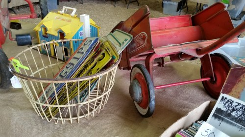 Vintage License Plates and Antique Wagon at Flea Market