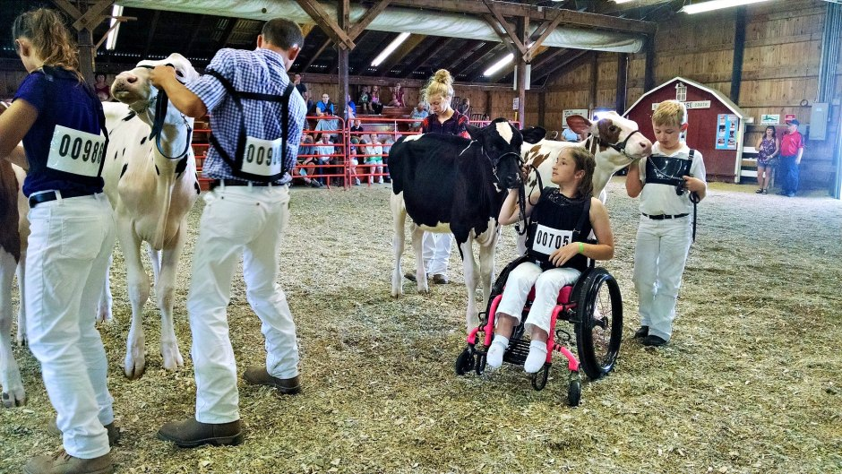 Caroline Powers shows her calf from wheelchair
