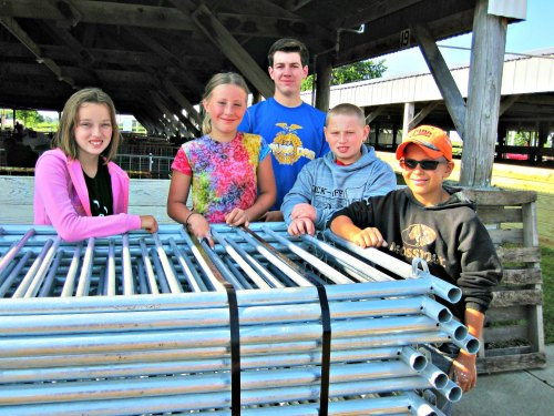 swine-project youth install donated pens