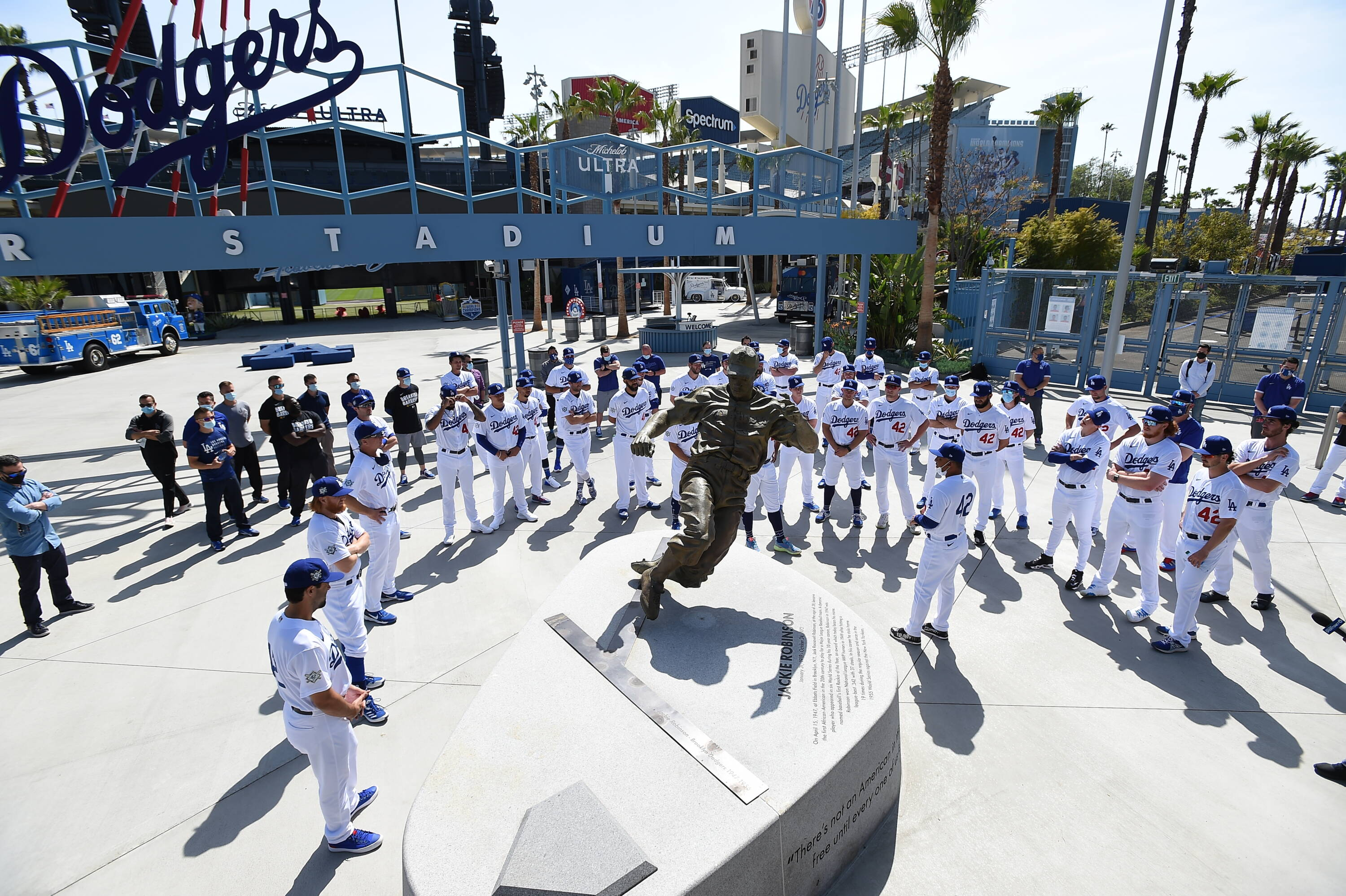 Dodgers Players and Coaches Gather Around Jackie Robinson's Statue to Reflect on His Legacy