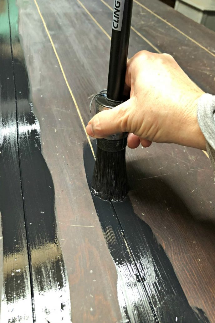 I painted the groove that I cut in the top of the wood table top to make the man cave furniture look more manly. #mancavefurniture