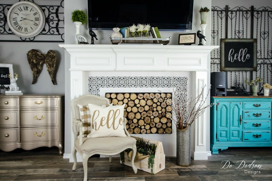 What do you think about the painted tiles? Learning to paint tiles around your fireplace is a great way to brighten up a space.