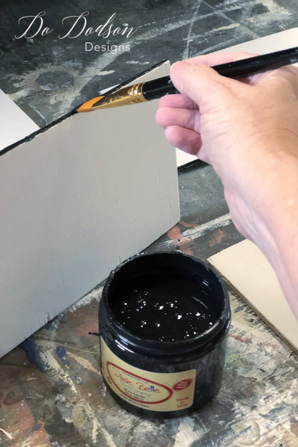 Paint the inside strips of the plywood black to make sure that the gaps between the faux shiplap looks authentic.