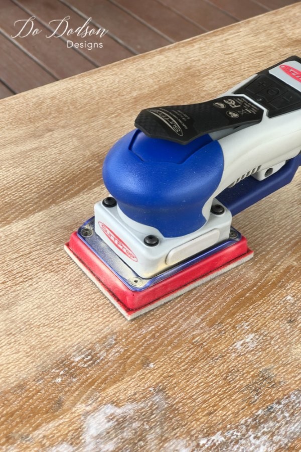 After one pass with the 3X4 Electric Ray Sander, I was sold! Not only did it remove the leftover paint but also the superficial stains.