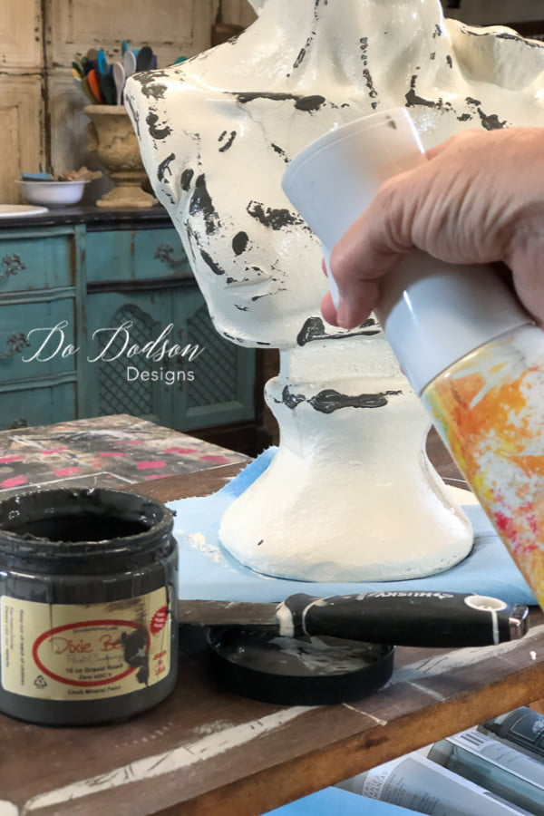 Before adding an aged patina finish on my thrift store find, I created a drippy finish with paint and a spray mist water bottle.