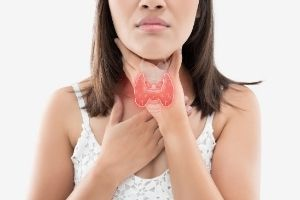 woman suffering from thyroid problem