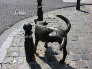 Peeing dog statue