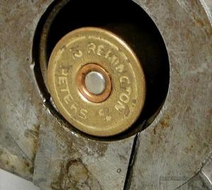 A 12 gauge shell loaded into a massive 4 gauge by A. Peterman, Philadelphia