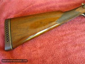 "20 gauge L.C. Smith Field Featherweight. 28"" bbls, straight-grip stock"