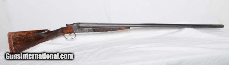 A couple nice Ithaca Double Barrel Shotguns    - Dogs and