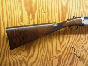 "28 gauge Ruger Red Label over under shotgun, 28"" barrels, straight grip"