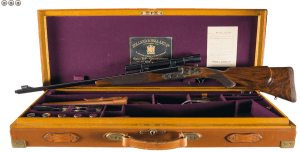 Cased Holland & Holland Engraved Royal Double Barreled Express Rifle in 7 M/M Magnum Flanged Cartridge with all H&H Accessories and Factory Documentation