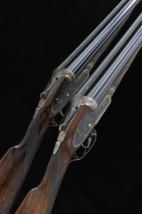 JOHN WILKES PAIR OF KELL-ENGRAVED 12-BORE SIDELOCK EJECTOR GUNS, NOS. 13802/3