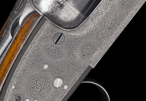 BOSS & CO. A RARE 12-BORE 'PURDEY-ACTION' SELF-OPENING SIDELOCK EJECTOR, serial no. 5633, with extra barrels