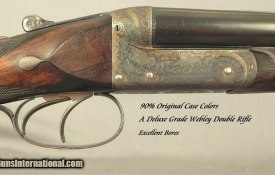 """JOSEPH LANG & SON 450 3 1/4"""" BPE- SxS DOUBLE RIFLE - 1897 DELUXE GRADE BOXLOCK TOPLEVER EJECT- EXC. PLUS BORES- 90% ORIG. CASE COLORS- 95% SUPERB & UNUSUAL ENGRAVING- O&L ORIG. TRUNK"""
