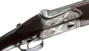 R. G.OWEN CUSTOM OVER UNDER 12 GAUGE WITH AN EXTRA SET OF BARRELS: