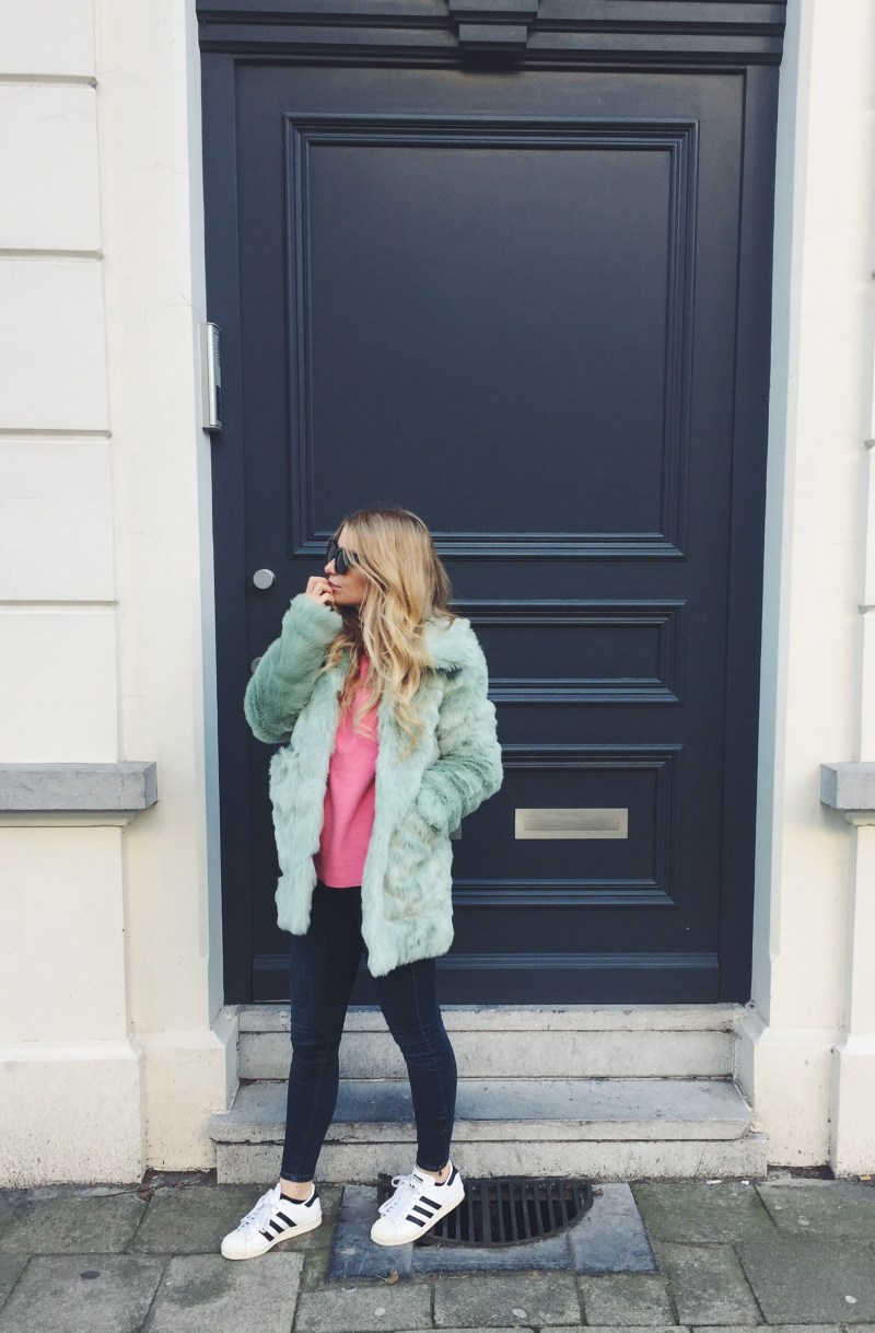 Pastel green faux fur and pink sweater Sundays wearing a pastel green faux fur coat and pink sweater