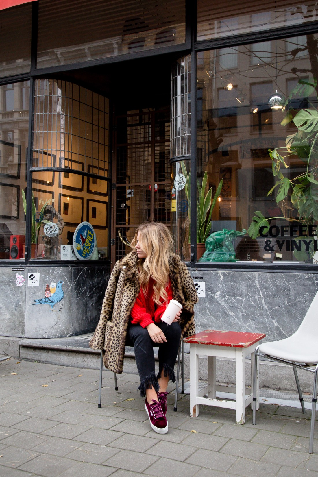 vleopard coat and red sweater streetstyle in Antwerp