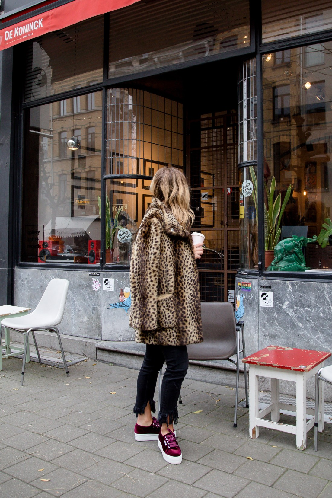 leopard coat and red sweater streetstyle in Antwerp