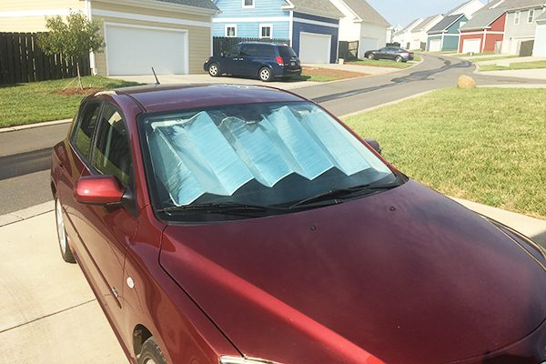 To help keep heat out, put a reflective sunshade on the interior of your front window.