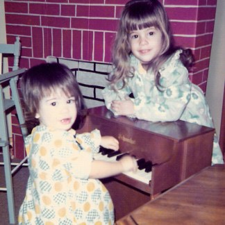 Sisters - Andrea and Jennifer as children playing piano