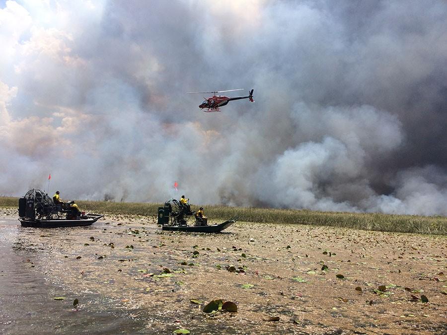 Firefighters monitor a prescribed burn at Arthur R. Marshall Loxahatchee National Wildlife Refuge.