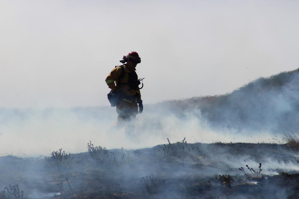 Firefighter stands in smoke at the Soberanes Fire.