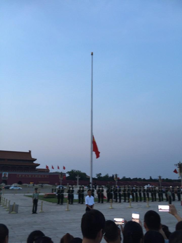 Tiananmen Square flag lowering scene.