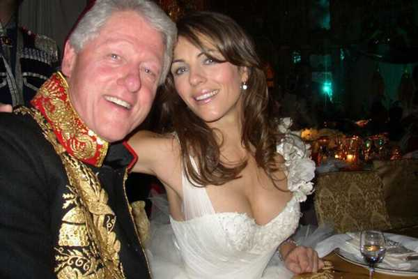 image_49316.bill-clinton-and-liz-hurley-at-a-charity-ball-3113948