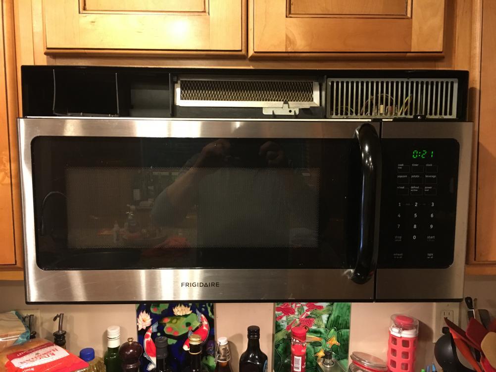 microwave hood fan cover keeps falling
