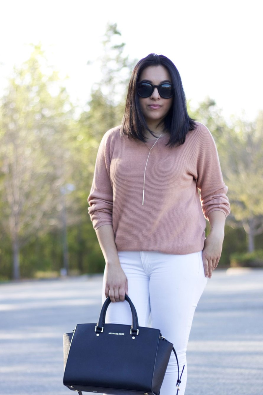 pink sweater black details
