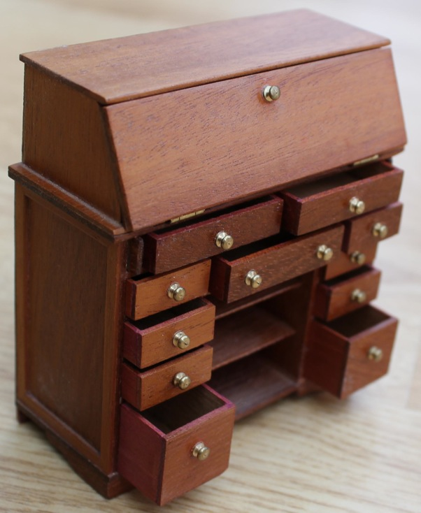 bureau with drawers open