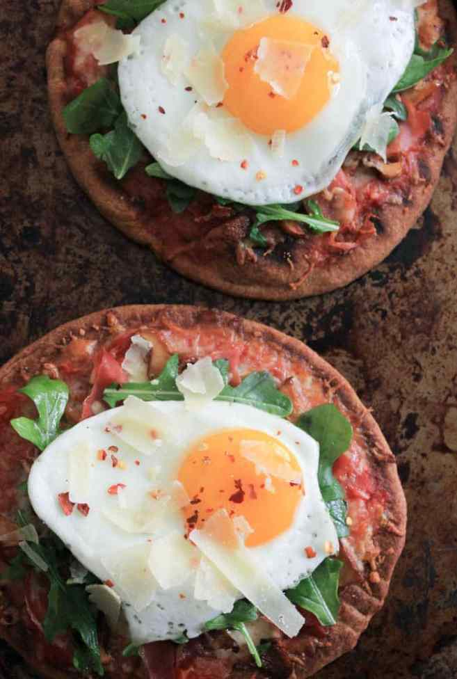 grilled-pita-pizzas-with-prosciutto-chanterelles-arugula-and-a-fried-egg