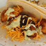 Beer Battered Fish Tacos with Avocado Jalapeño Sauce