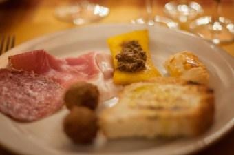 Meatballs, cured meats, polenta with boar sauce