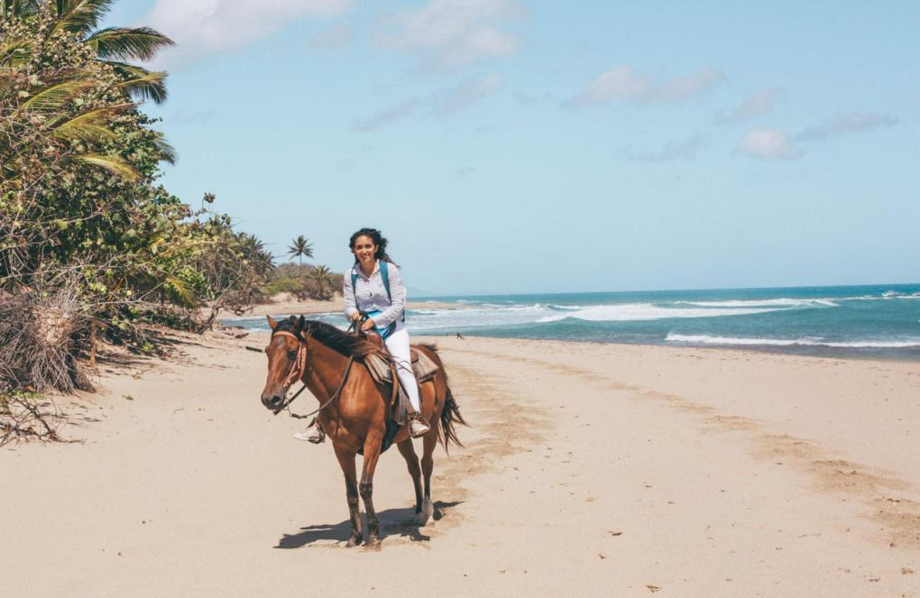 Horseback riding along the beach at Seahorse Ranch in  Cabarete.