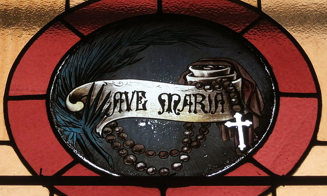 Stained glass window of the Rosary