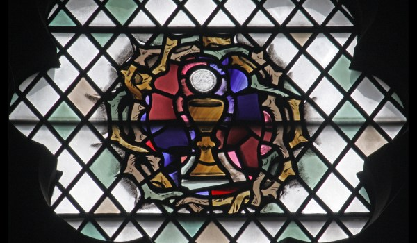 A chalice encircled by a crown of thorns.