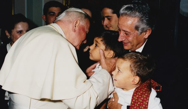 Image: Young Br. Josemaría and his family with Pope St. John Paul II.