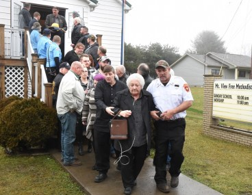 Okey Dalton wife Barbara leaves Mt View Free Methodist Church after funeral.