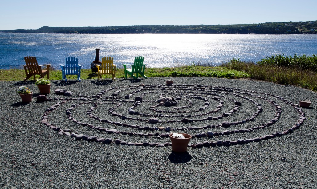 Seven circuit stone labyrinth on the edge of sea.
