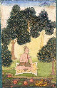 Yogi seated in a garden.