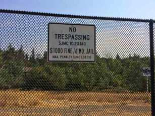 "A new fence was recently built around parts of ""The Jungle"" with this ominous sign."