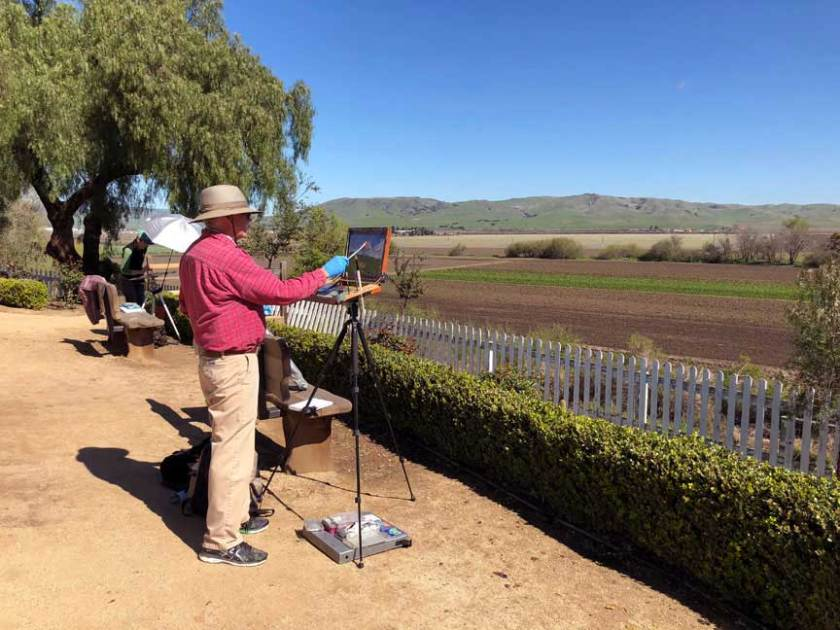 Al Shamble painting the fields of San Juan Bautista