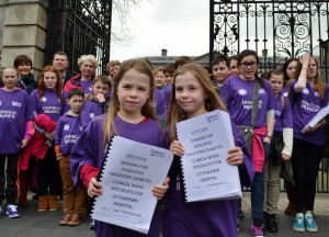 Donegal's children with diabetes present their petition to Health Minister Dr. James Reilly at Dáil Éireann. In front: Rianna and Alyssa Kelly.